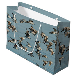 Sanderlings Take Flight in the Winter Skies Large Gift Bag