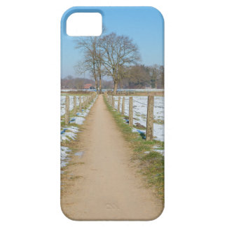 Sandpath between snowy meadows in dutch winter iPhone 5 covers