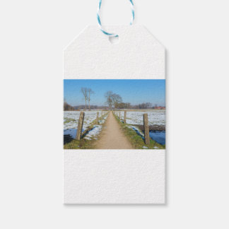 Sandpath between snowy meadows in dutch winter pack of gift tags