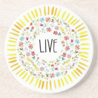 Sandstone coaster with flowers and the word live