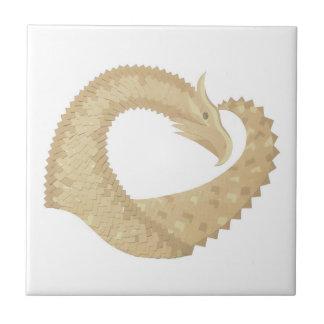 Sandstone heart dragon on white tile