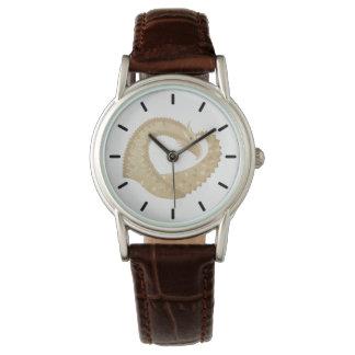 Sandstone heart dragon on white watch