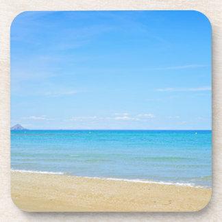 Sandy beach and blue Mediterranean sea Coaster