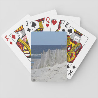 Sandy beach and weathered beach fence playing cards