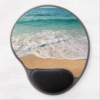 Sandy beach at noon with blue water and clear sky gel mouse pad