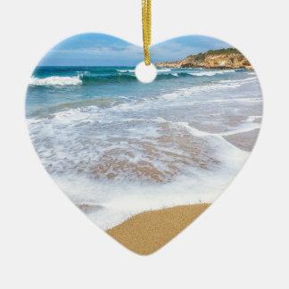 Sandy beach sea waves and mountain at coast ceramic heart ornament