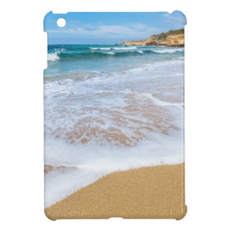 Sandy beach sea waves and mountain at coast cover for the iPad mini