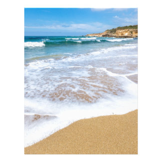 Sandy beach sea waves and mountain at coast letterhead