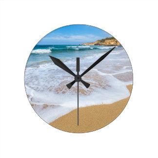 Sandy beach sea waves and mountain at coast round clock