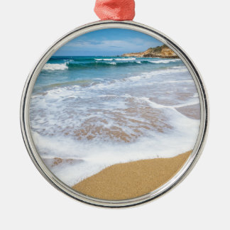 Sandy beach sea waves and mountain at coast Silver-Colored round ornament