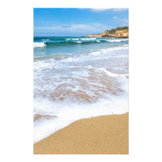Sandy beach sea waves and mountain at coast stationery