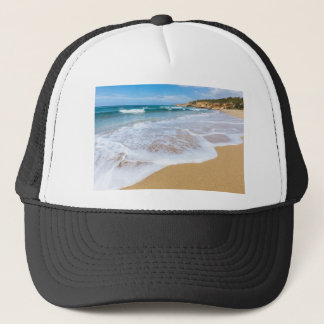 Sandy beach sea waves and mountain at coast trucker hat