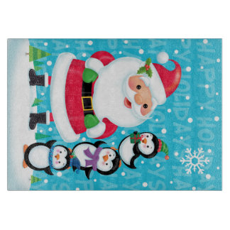 Santa and Penguins Glass Cutting Board