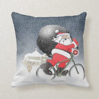 Santa bicycling with sack and snow pillow