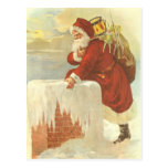 Santa Claus Climbing Down the Chimney with Toys Postcards