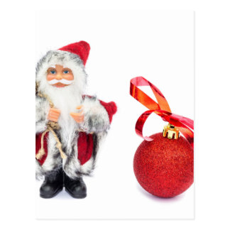 Santa Claus figurine with red christmas ball Postcard