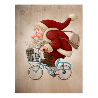 Santa Claus rides the bicycle Post Card