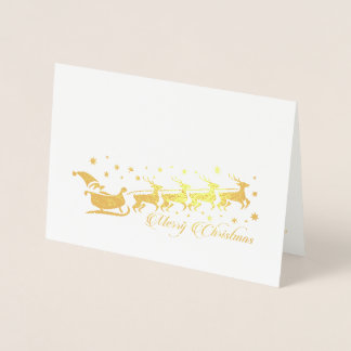 Santa Claus riding with his reindeers and sleigh Foil Card
