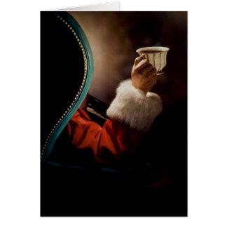 Santa Claus taking a break on Christmas Eve Card