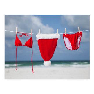 Santa hat and bikini on a clothesline postcard