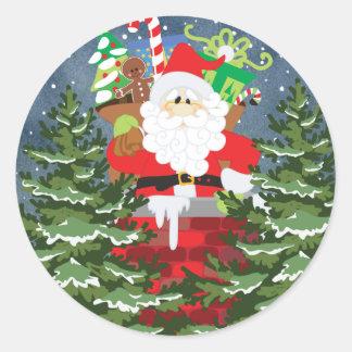 Santa in a chimney starry night classic round sticker