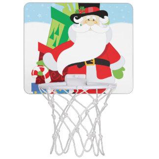 santa in tophat by  stack of presentts mini basketball hoop