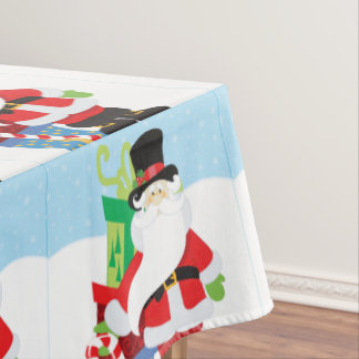 santa in tophat by  stack of presentts tablecloth