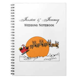 Santa Reindeer Over Snow Covered Town Moon Notebooks