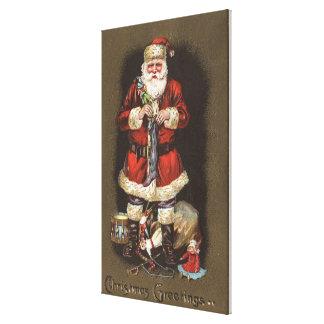 Santa Stuffing Stocking with Nutcracker Canvas Prints