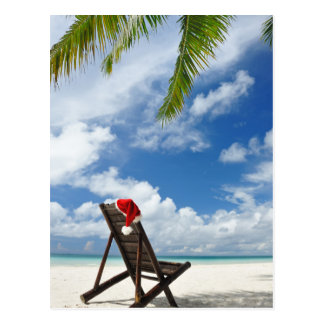Santa's hat and chaise lounge on the beach postcard