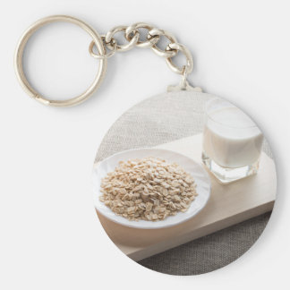 Saucer of cereal and a glass of milk in the backli basic round button keychain