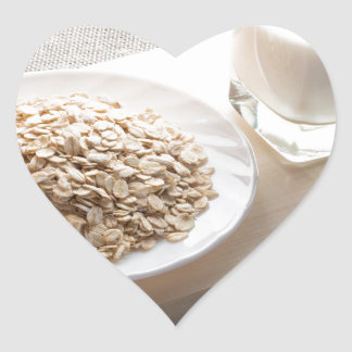Saucer of cereal and a glass of milk in the backli heart sticker