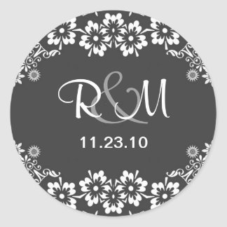 save the date sticker with monogram and date
