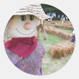 Scarecrow in a Pumpkin Patch Round Sticker