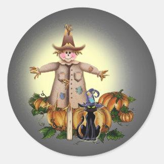 SCARECROW, PUMPKINS & CAT by SHARON SHARPE Round Sticker
