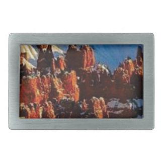 scenes of the snowy red rock rectangular belt buckle