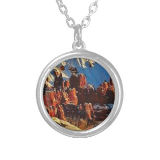 scenes of the snowy red rock silver plated necklace