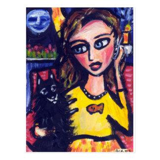 Schipperke hugs woman on phone postcard