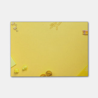 School Accessories on Yellow Background Post-it Notes