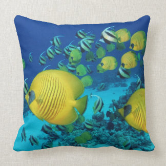 School of Butterfly Fish Swimming on the Seabed Throw Pillows