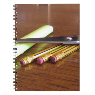 School office supplies on wooden table notebook