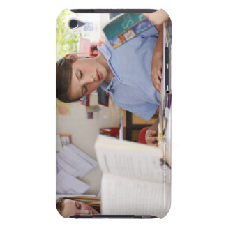 schoolgirl concentrating on reading in class iPod touch cover