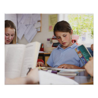 schoolgirl concentrating on reading in class poster