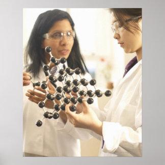 Scientists examining molecular model poster