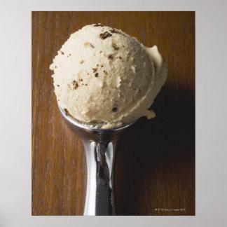 Scoop of ice cream in ice cream scoop (overhead print