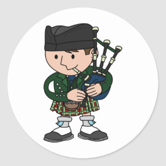 Scottish bagpiper playing bagpipes classic round sticker
