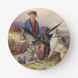Scottish boy with wolfhounds in a Highland landsca Round Clock