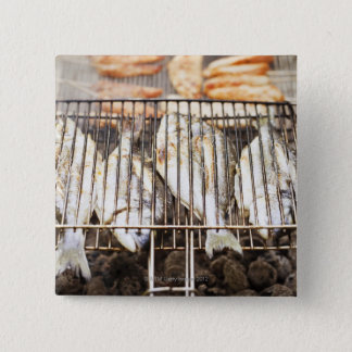 Sea breams on barbecue grill. 2 inch square button