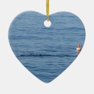 Sea diver in scuba suit swim in water ceramic ornament