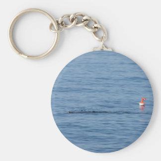 Sea diver in scuba suit swim in water keychain
